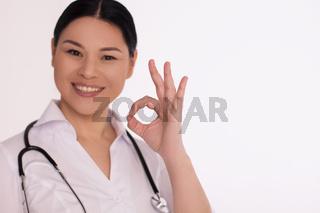 Nurse showing OK sign.