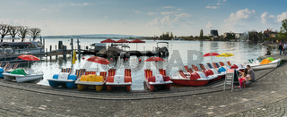 Zug, ZG / Switzerland - 20 April, 2019: panorama view of Lake Zug lake shore with the paddle boat rental station on a beautiful spring day