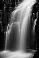 Powerful waterfall flowing down cliff ledge