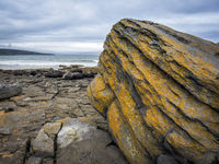 Massive rock on the coastline of Ireland Fanore beach