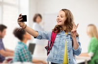 teenage student girl taking selfie by smartphone