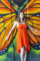 Lovely Brunette Model Posing Outdoors Against Graffiti