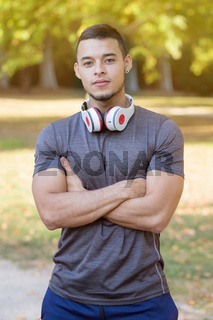 Young latin man runner running jogging sports training fitness workout portrait format