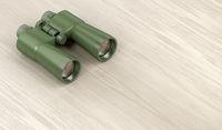 Military binoculars on wood background