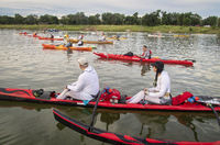 paddlers at a start of river race
