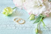 Bouquet of flowers with two gold rings