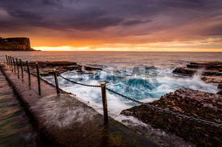 Coastal sunrise by ocean pool