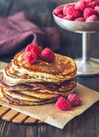 Stack of pancakes with fresh raspberries