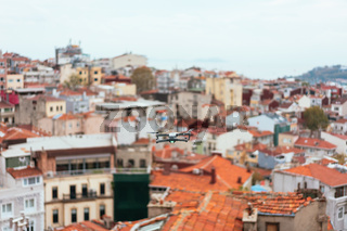 Drone flying above old city, selective focus