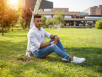 Attractive young man in a city park