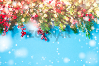 Christmas border design, fir tree branches on the blue