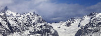 High snowy mountains and glacier at sunny day