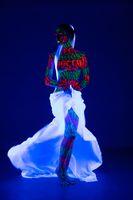 Girl with artisitc UV bodyart full-length shot