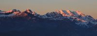 High mountains in the Bernese Oberland at sunrise. Bluemlisalp Range. View from Mount Niederhorn, Beatenberg.