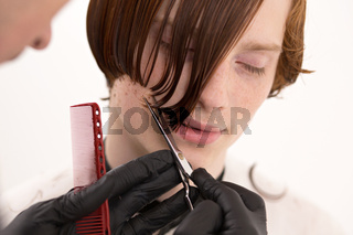 Closeup Of Man's Face When His Red Hair Is Being Cut