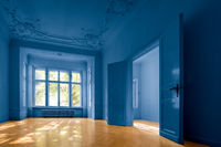empty room in old apartment building with  parquet floor  and blue painted walls