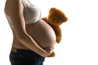 pregnant woman, expectant mother on white background, close-up of pregnant belly