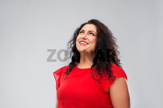 happy smiling woman in red dress looking up