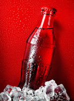 Cola on a red background