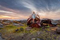 Female exploring rusting shipwrecks along Australian coast