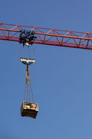 Red Crane Arm Holding Load Construction Industry
