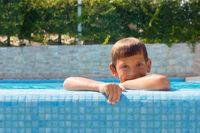 Happy boy at swimming pool