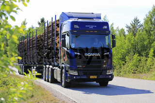 NextGen Scania R730 XT Logging Truck on Forest Road