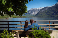 Couple on a bench looking at the mountains.