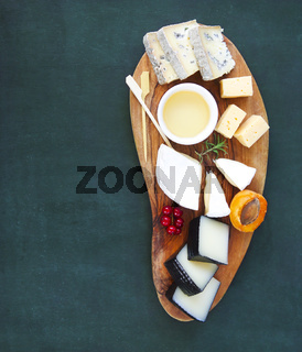 Plate antipasti snack on the wooden board