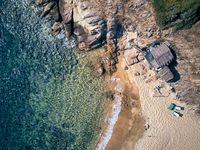 Man in hammock on a beach aerial view