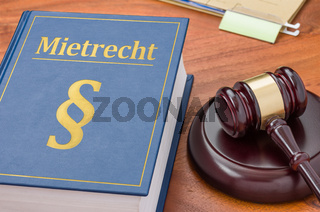 A law book with a gavel - Mietrecht (German word for Tenancy law)