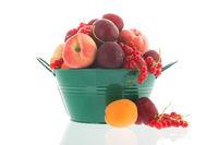 Green bucket fresh summer fruit