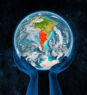 Argentina on planet Earth in hands
