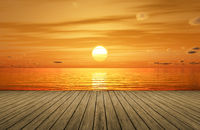 a beautiful golden sunset over the ocean and a wooden jetty