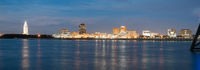 Horizontal composition covering the Mississippi River waterfront and the State Capitol of Louisiana at Baton Rouge