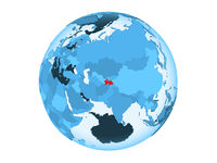 Tajikistan on blue globe isolated
