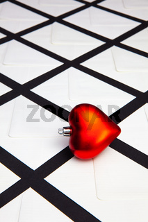 Composition with white envelopes and red heart.
