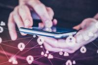holding mobile phone doing social media  on  smartphone