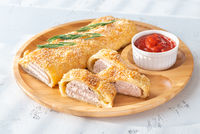 Sausage rolls with tomato sauce