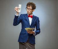 Man holding fan of dollar banknotes