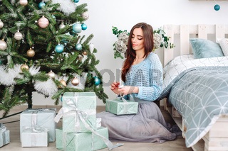 smiling woman with many gift boxes