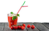 Glass of tomato juice with cocktail stick