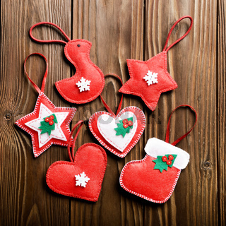Handmade rustic Christmas tree decorations on wooden table