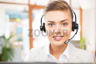 helpline operator in headset working at office