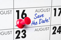 Wall calendar with a red pin - August 16