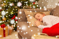 girl sleeping on sofa at christmas