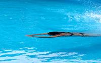 Woman swimming in open air swim pool