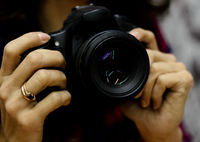 the digital camera in hands