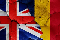 flags of UK and Chad painted on cracked wall
