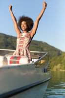 Beauty sexy afro american girl with perfect thin figure enjoying boat ride